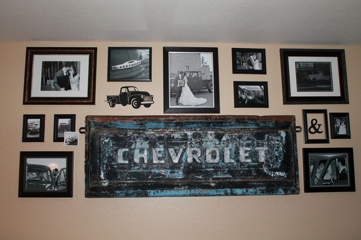 Gallery wall made with an old tailgate and all my wedding photos with my great-grandfather's 1952 Chevy pickup truck.