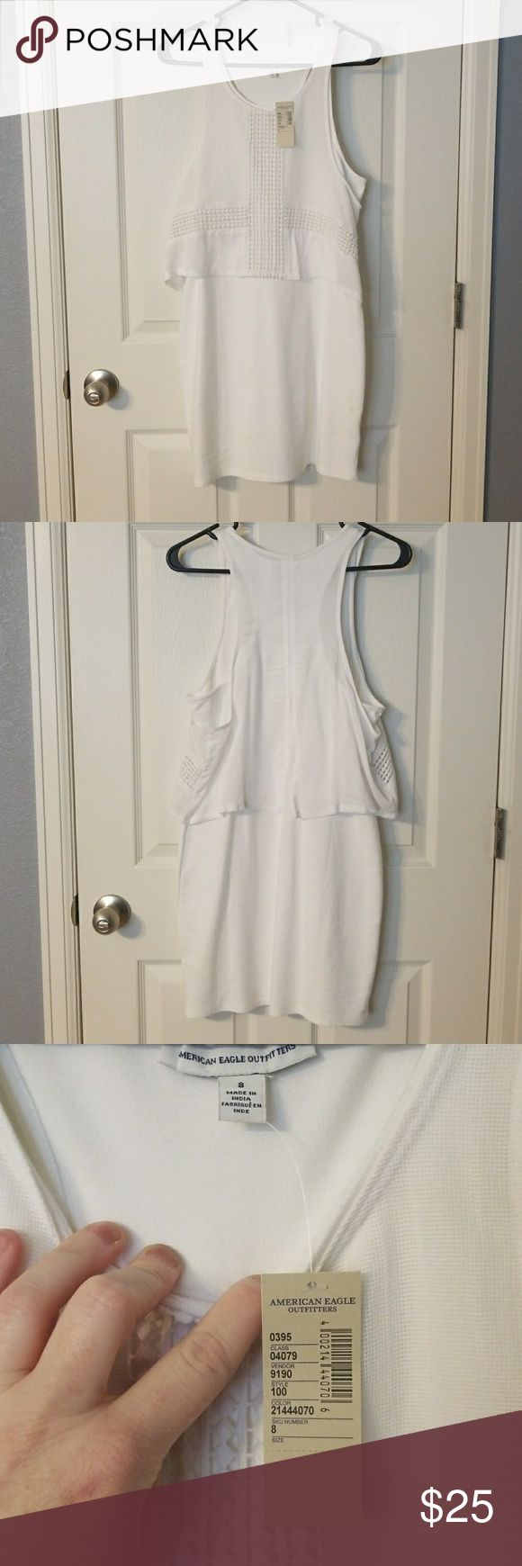 "American Eagle White Dress Never worn tags on.  White Bodycon dress with white cross pattern tank overlay.  All one piece.  Very cute! 27"" from front neckline to bottom. American Eagle Outfitters Dresses Midi"