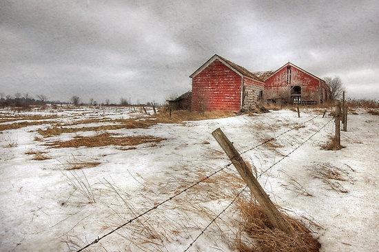 A dilapidated barn and farmland for sale along a rural road near Alexandria Bay, upstate New York, USA.