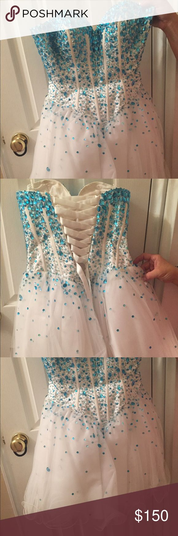 Mori Lee dress Short, fit and flare, corset back. Worn for 3 hours, very good condition. Beautiful turquoise beading Mori Lee Dresses Prom