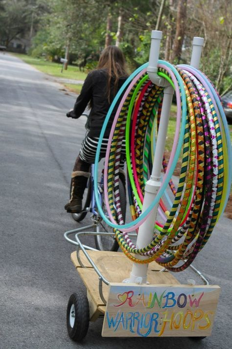 Why doesn't this guy ride past my house? Where's my hula hoop delivery man!?!? This idea is brilliant totally doing this next summer!!