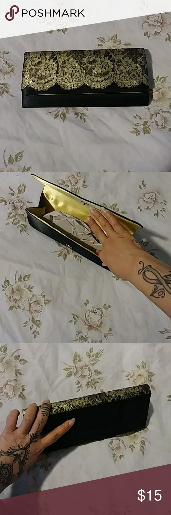 """Gold and black clutch Gold and black clutch.  No strap.  Brand new without tags.  The """"lace"""" Is gold glitter paint.  Absolutely gorgeous.  Black is satin material. Inside is gold satin material.  Smoke and pet free home. Bags Clutches & Wristlets"""