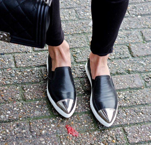 Nappa leather skate-style sneaker by Miu Miu. Slip-on style. Silver metal Miu Miu logo cap at almond toe.