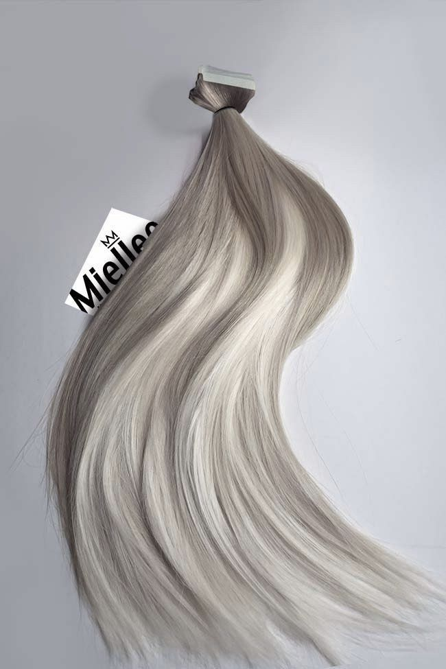 """The MEDIUM ASH BLONDE BALAYAGE is blend of wheat blonde roots and frosty blonde tips. Hands down one the best selling items in our shop.  Product Details:   Seamless tape in extensions Pre-taped & ready to use Made of Remy Human Hair Sourced from donors in Russia Featuring a silky straight texture Perfectly healthy with cuticles intact Double drawn for extra fullness Thick from top to bottom    NOTES: Each piece is 1.5"""" wide and weighs avg 3g. We suggest 20-40 pcs for a partial head, 40-6..."""