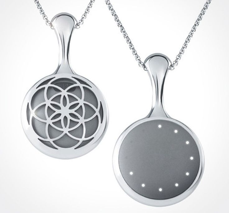 The Misfit Shine necklace is a floral, stainless steel necklace that holds a tiny, quarter-sized fitness tracker.