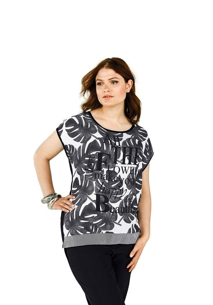Typ , T-Shirt,  Materialzusammensetzung , 100% Polyester / 95% Viskose, 5% Elasthan,  Ausschnitt , Rundhalsausschnitt,  Ärmelstil , überschnittene Ärmel,  Bündchen , Rippbündchen vorn am Saum,  Optik , Vorne komplett bedruckt, Schriftzug+Ziersteinen, hinten unifarben schwarz,  Gesamtlänge , größenangepasste Länge 72-80cm hinten,  Ärmellänge , kurzarm,   ...