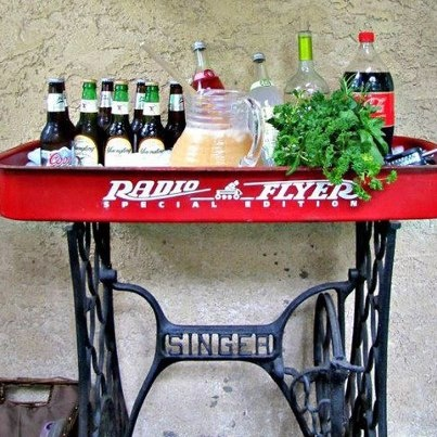 Ummm....with patio coolers all the rage.  (We have sold about 10 washtubs for that purpose this summer)  I thought this was a cool take on that idea.  We find sewing machine bases all the time!  Not sure Iwould trash a wagon this nioce, but hey why not!