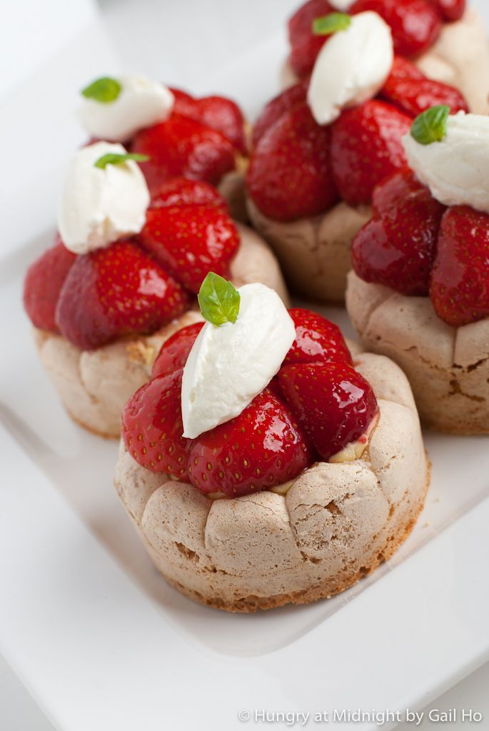 Strawberry dacquoise: A classic french pastry in a new way with strawberries and a basil pastry cream.