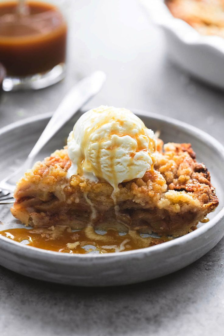 Easiest and best ever apple crumble pie with a pie crust bottom, gooey cinnamon apple filling, crumble topping, vanilla ice cream, and warm…
