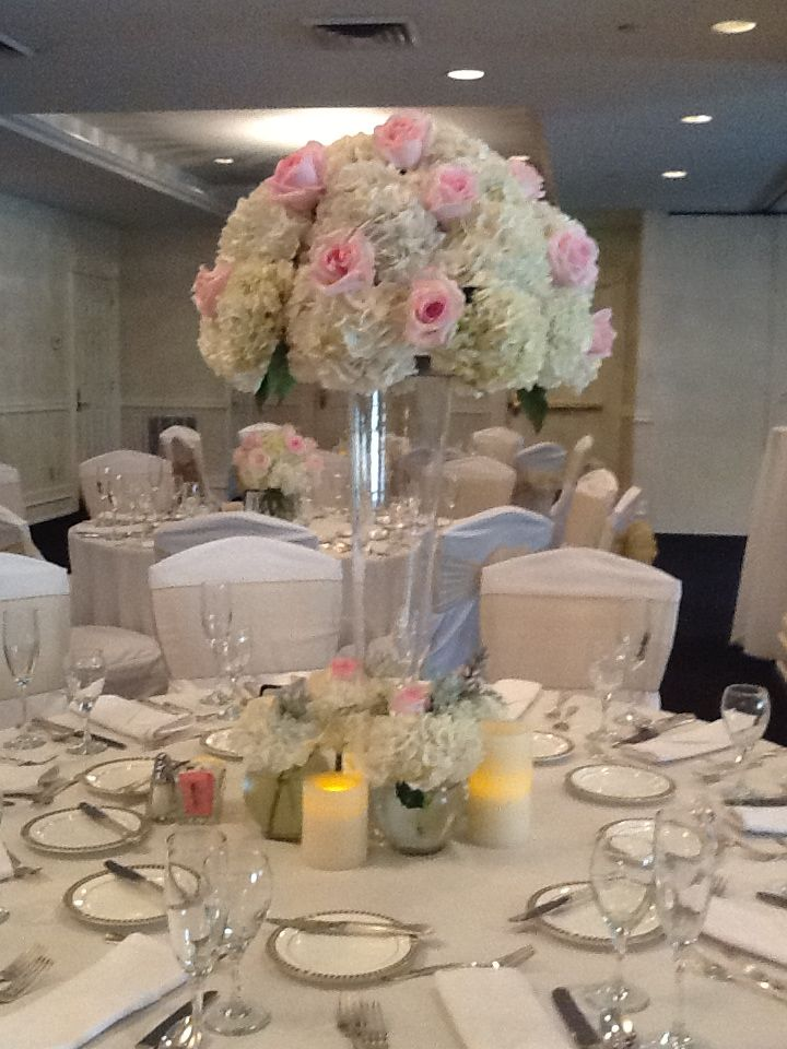 Tall wedding centerpieces with white hydrangea and pink