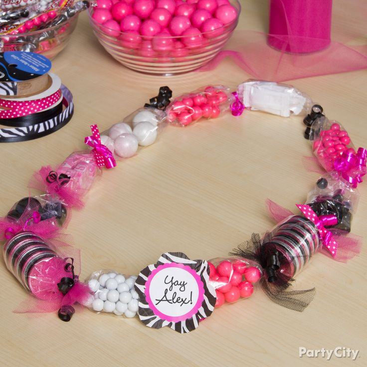 Great idea for a kids party. They can make their own lei and then take it home.