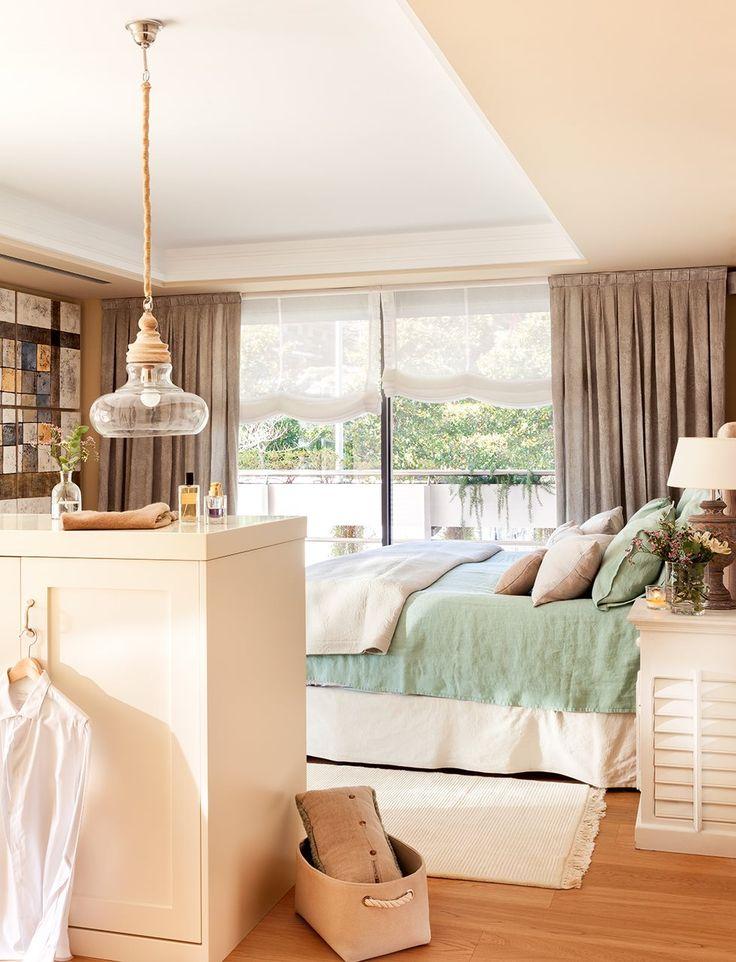 Dormitorio con vestidor en tonos beige