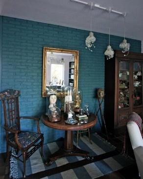 Painted brick wall, revived with a new color.  Courtesy of houzz.com.