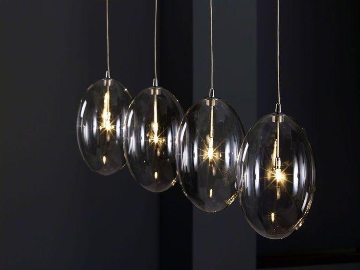 Lampen kunnen je woonkamer een aangename sfeer geven deze moderne hanglamp is een typisch - Een rechthoekige woonkamer geven ...