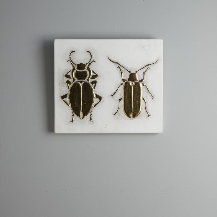 Beetle III. 23 x 20 cm. Two raised gesso beetles gilded with 23.5 carat gold leaf on a white gesso background.
