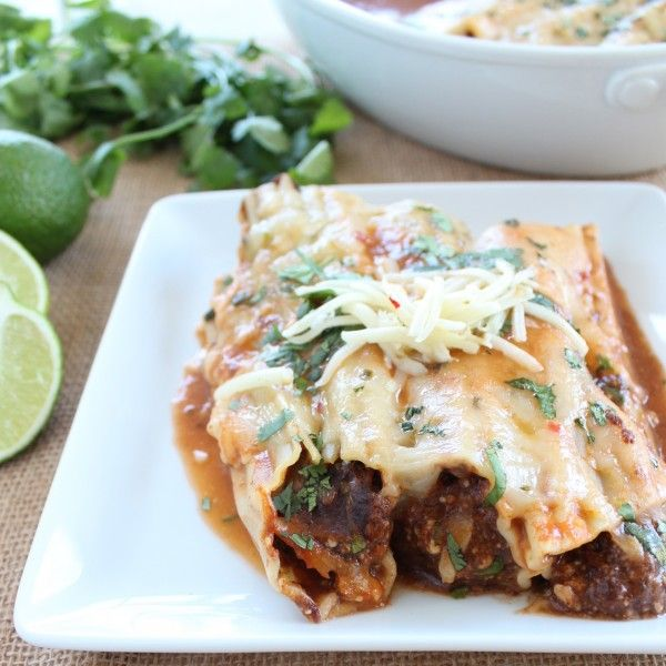Vegetarian Mexican Manicotti is filled with black beans, cheese and spices, then topped with a tortilla soup sauce for a delicious dinner recipe.
