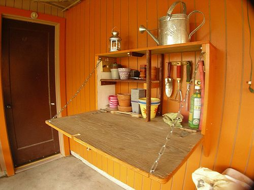 how easy to make a potting station from a cupboard mounted on it's side?   wow.... inspiration