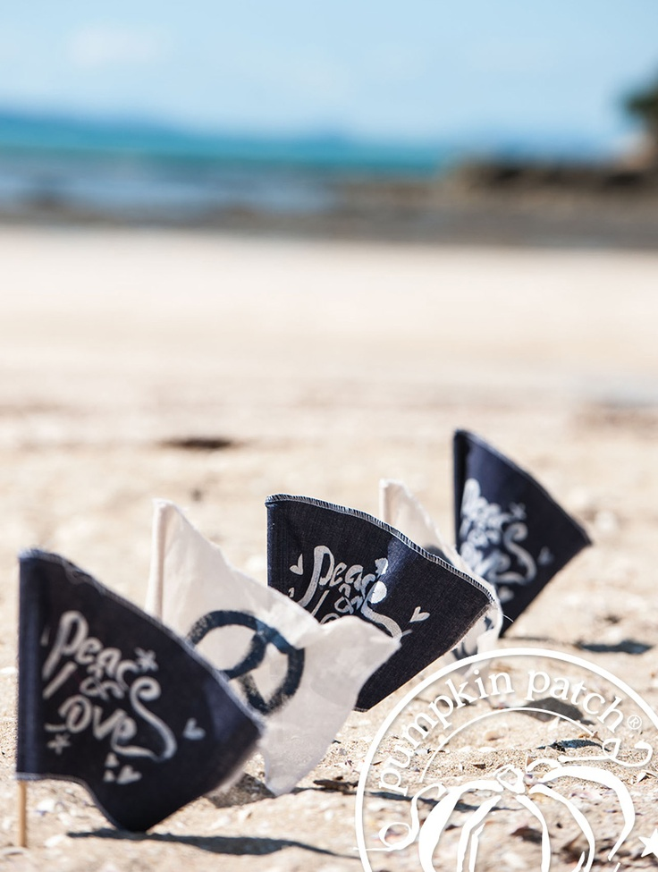 Flags in the sand for the Pumpkin Patch Summer 2012 kidswear fashion collection.