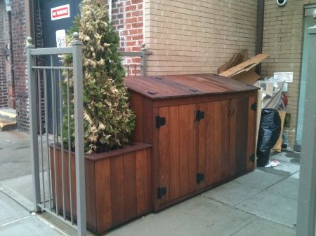 the trash shed I like for the side yard- i would want planters on each end