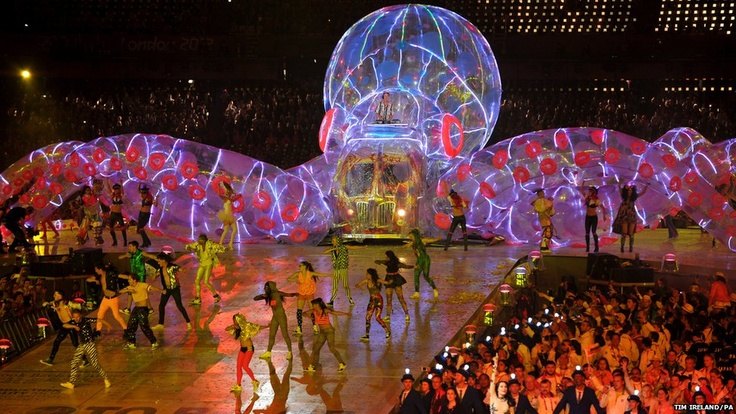 During the Closing Ceremony of the 2012 London Olympics, the crowd was taken through a celebration of British eccentricity, with comedian Russell Brand singing Pure Imagination from Roald Dahl's Willy Wonka and the Chocolate Factory and the Beatles' I am the Walrus from the top of a psychedelic bus. Brand was followed by DJ Fatboy Slim aka Norman Cook