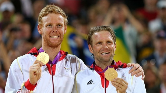 Gold medallists Jonas Reckermann and Julius Brink of Germany celebrate with their medals - Beach Volleyball