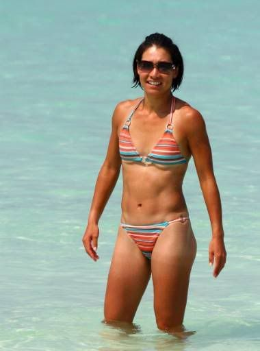 Kimiko Date-Krumm in a bikini - A nice shot of Kimiko as she's vacationing in 2009. Clearly Kimiko was keeping herself in shape, check out her abs! About four years after this photo was take, Kimiko returned to women's tennis at 37 years of age.