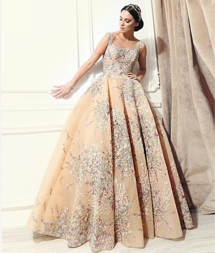 Just peachy! This peach-toned couture #gown by Reem Kachmar has its own rainbow bouquet embroidered into the bodice and skirt! | WedLuxe Magazine | #wedding #luxury #weddinginspiration #luxurywedding #bridal #fashion #weddingdress #weddinggown