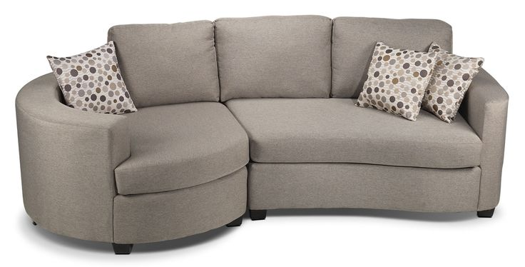 """Gentle Curves. The curved lines of the Andrea sectional sofa welcome you to sit down, relax and curl up for a while. A heathered graphite finish and soft contours present a casually modern look. Small wedge feet supply a little lift while the toss pillows' accent fabric with small, multihued circles and wavy, white lines provide a contemporary """"pop"""" in your living room. Two-piece sectional includes left-facing bumper loveseat and right-facing curved loveseat, as shown."""