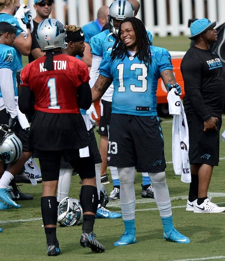 Carolina Panthers quarterback Cam Newton, left and wide receiver Kelvin Benjamin, right, talk during practice on Friday, July 29, 2016 at…