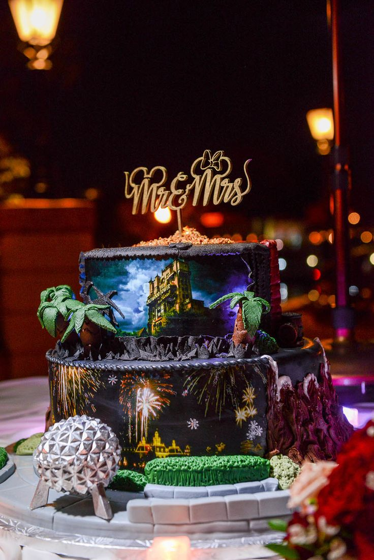 Disney Wedding Cake Wednesday: Walt Disney World Favorites - super cool cake! (Be sure to look at the closeups).