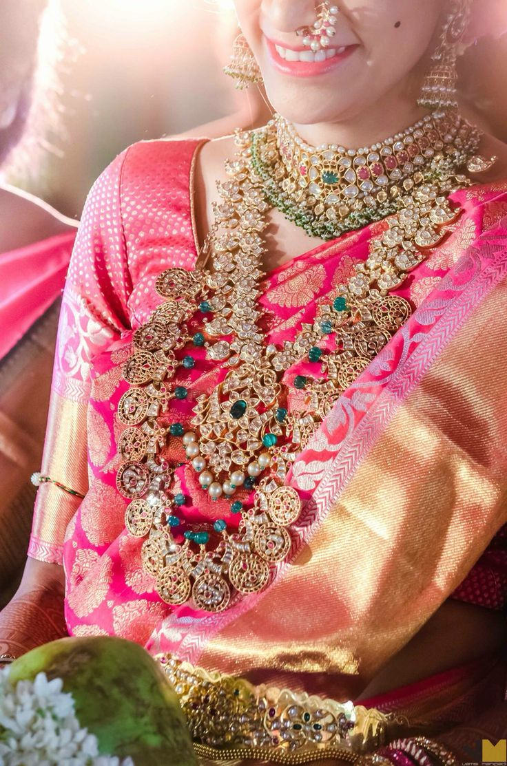 South Indian bride. Diamond Indian bridal jewelry. Jhumkis.Pink silk kanchipuram sari.Braid with fresh jasmine flowers. Tamil bride. Telugu bride. Kannada bride. Hindu bride. Malayalee bride.Kerala bride.South Indian wedding.