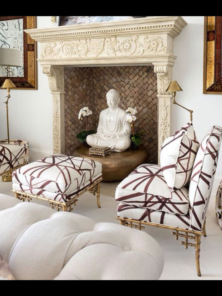 Chinoiserie gold leaf bamboo leg chairs, and Buddha in a Brick and French Limestone Fireplace.