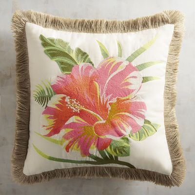 Paradise found: Thanks to the pretty retro vibe of our Embroidered Hibiscus Pillow—complete with flirty fringe trim—your sofa or deck chair can become your own tropical oasis.