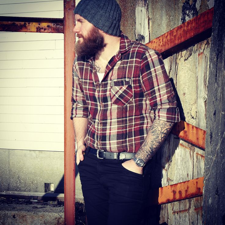 Absolute man! Tattoos, knitted hat, plaided shirt, and a beard! Recipe for success!