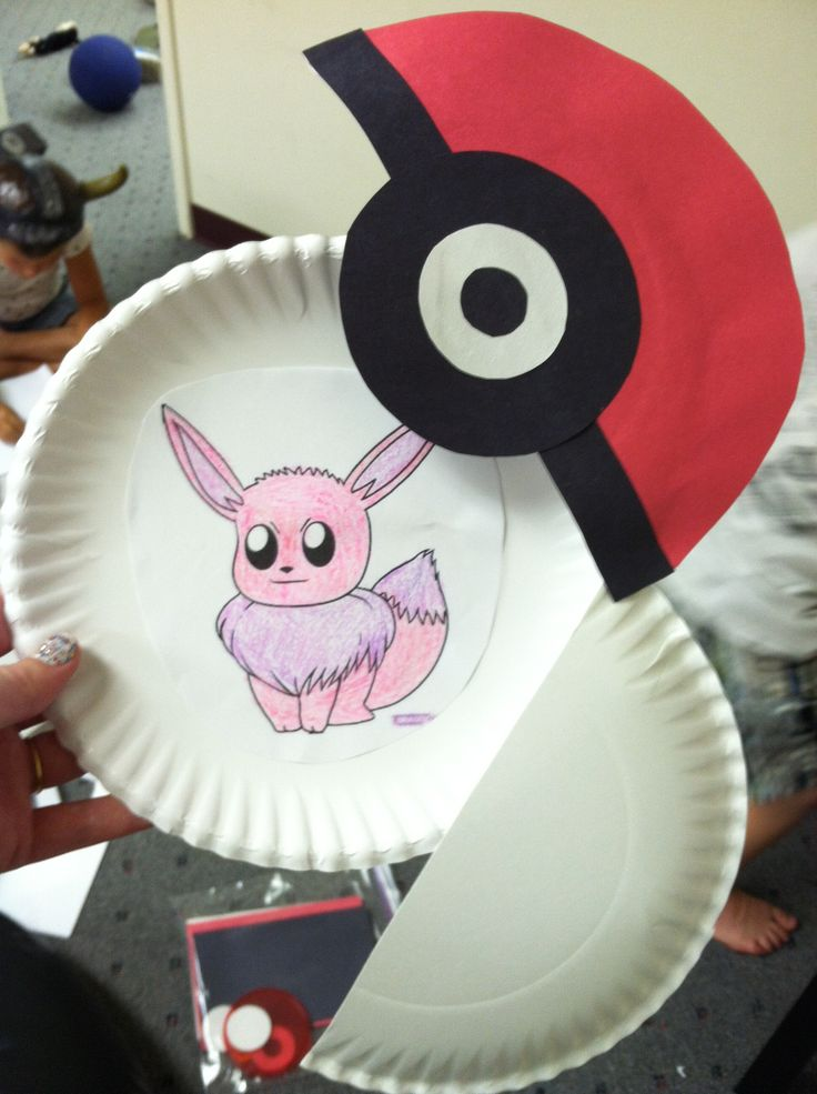 opening pokeballs made from paper plates and construction