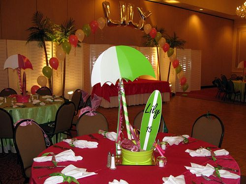 These custom beach centerpieces included umbrellas surf