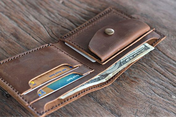 Our newest creation was requested by many, many customers.    Weve added a coin pocket to our favorite bread and butter design, the Euro wallet.    This