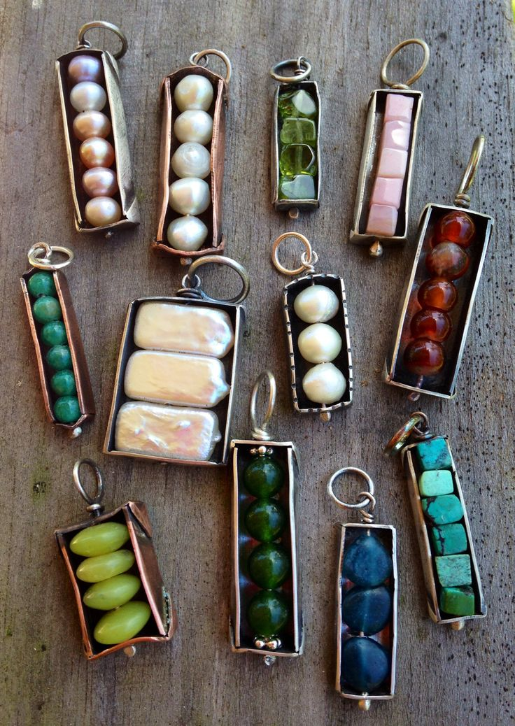 """Sterling silver and copper """"bead box"""" companion pendants with a variety of stones."""