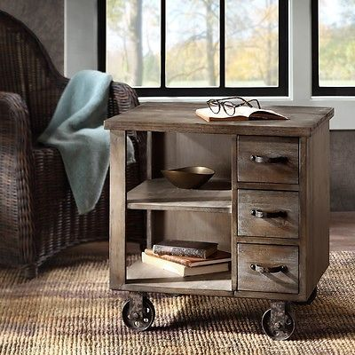 Wood end table rustic farmhouse side accent nightstand urban industrial decor wood end table descriptionthis wood endtable will update your home's décor. This accent side table on wheelsfeatures a durable wood construction, finished in a warm reclaimed grey withthree working drawers and two shelves for extra storage. Perfect for your rustic farmhouse or urban industrialdécor.featuresengineered wood, fir veneers, ironweathered grey finishwheels are stationarywipe clean with damp clothassem...