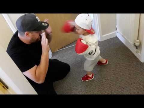 Kid boxing his dad's hands http://j.mp/2mYJWxP