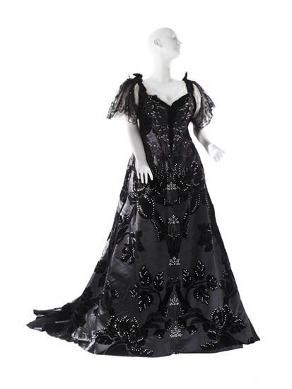 Evening Gown, House of Worth: 1894, French, voided velvet with floral  and foliate motif, applied brilliants, Chantilly lace, tulle, net with brilliants and jet beads in stylized floral pattern, jet beads and brilliant tassels.