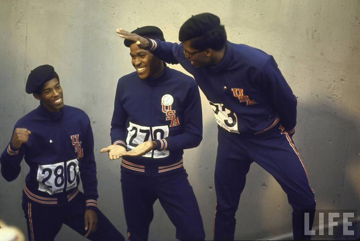 Summer Olympics, 1968. Lee Evans (C) Larry James (L) and Ronald Freeman (R) after their victory for the 400 meter race