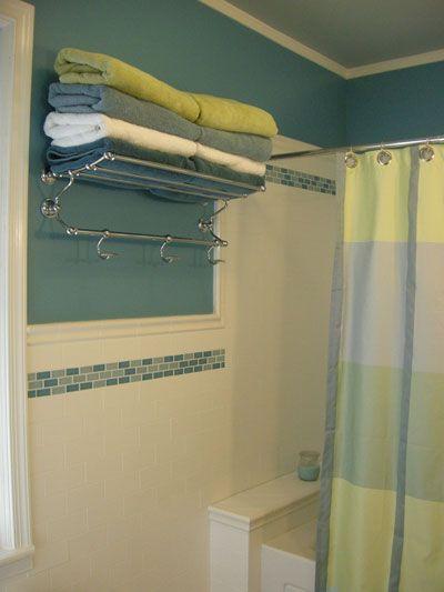 Towel shelf...small bathroom...subway tile looks awesome!