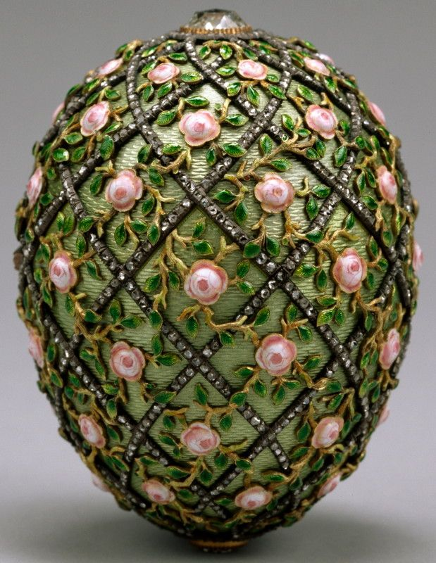 "Rose Trellis Faberge Egg, 1907 ~ presented by Nicholas II to Czarina Alexandra Fyodorovna  -- ""Originally the egg contained an oval jeweled locket in which the surprise was hidden. Only the impression on the satin lining now remains. Research indicates the surprise was a diamond chain with a watercolor miniature of the little Tsarevich Alexei, painted on ivory."" [text from website]"