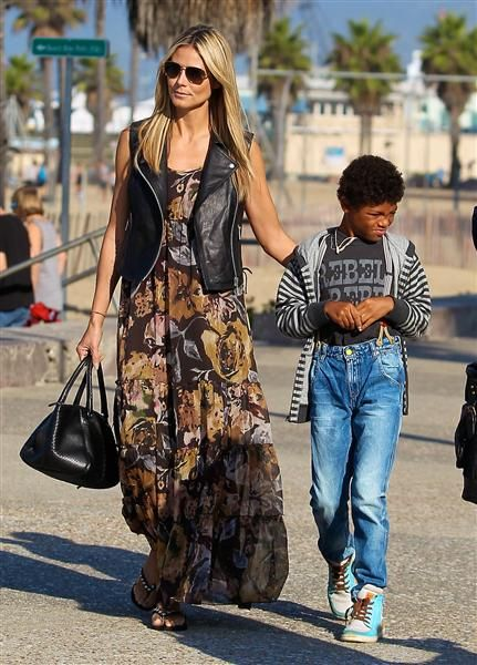 Heidi Klum worked a black leather vest over a floral-print maxi-dress while getting breakfast with her kids in Santa Monica, Calif.