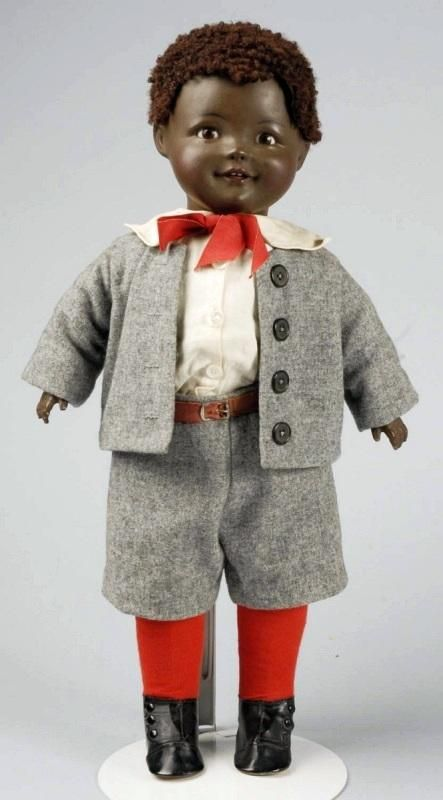 """17"""" composition and cloth boy doll with earthenware head, designed by American artist Jeanne Orsini, glass sleeping eyes, wearing original schoolboy outfit, Germany, 1920, by J. I. Orsini."""
