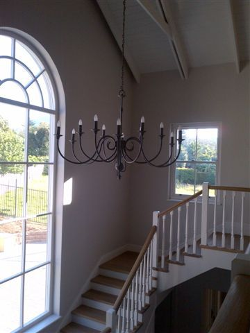 One of our latest installations.. The Bastille Grande 12 arm chandelier.. And look at the arched window! Simply divine!