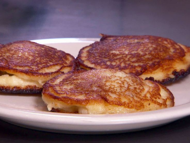 Byelorussian Kolduny (Potato Pancakes Stuffed with Ground Meat) recipe from Diners, Drive-Ins and Dives via Food Network