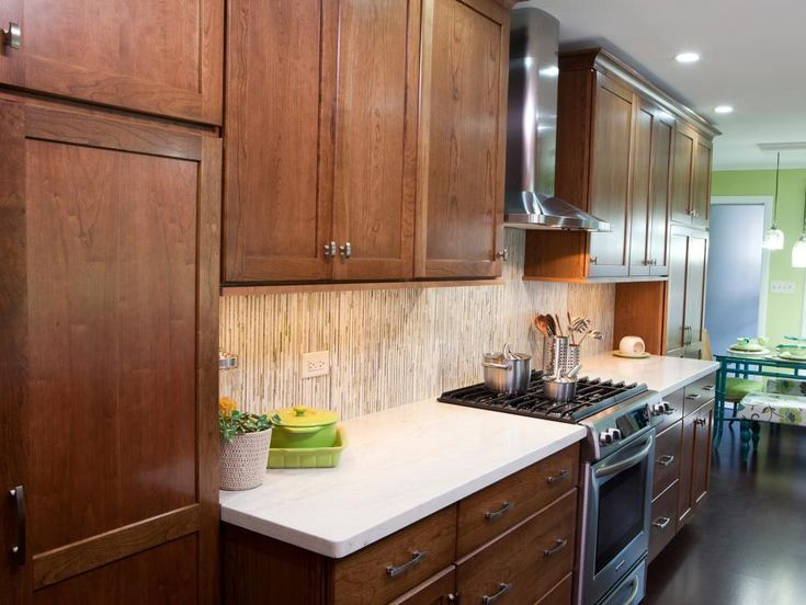 As seen on HGTV's Great Rooms, this newly-remodeled kitchen has a fresh backsplash, range, ready to assemble cabinets and space leading to dining area.