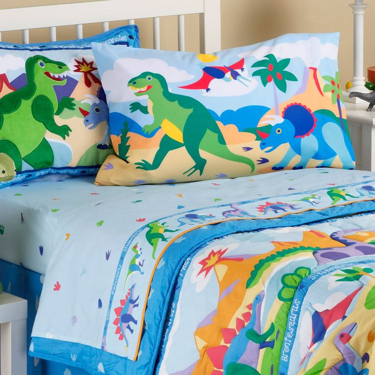 sheet features colorful dino footprints printed a light blue ground on ultra soft percale cotton the hem is sewn on a row of marching dinosaurs